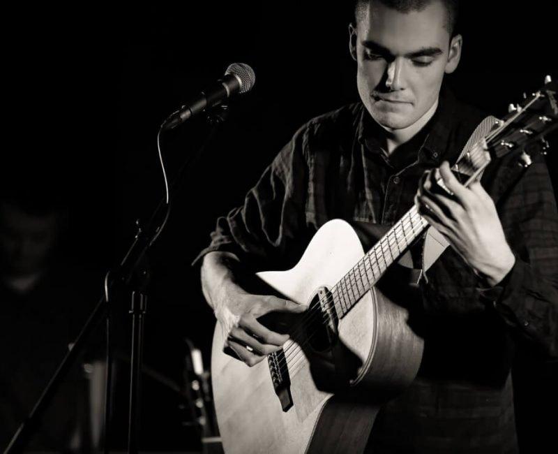 Henry Bateman playing guitar live